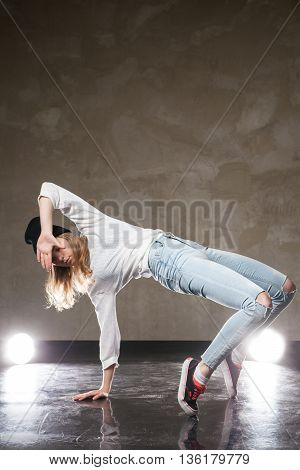 Portrait of young woman performing street dance.Studio shot
