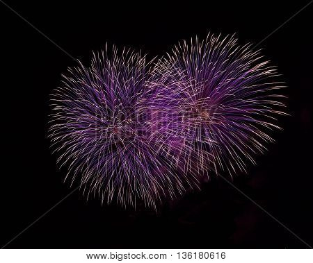 Blue and violet colorful fireworks in black background,artistic fireworks in Malta,Malta fireworks festival in dark background,colorful fireworks,long exposure of fireworks,explosion close up,4 July