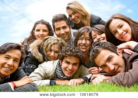 happy group of friends smiling outdoors in a park