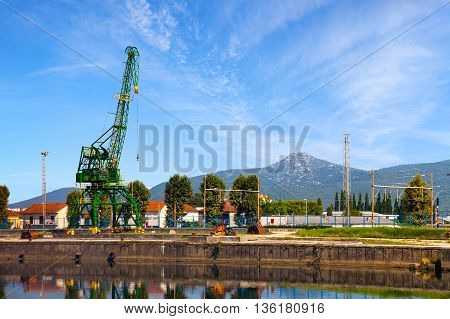 Small crane on the edge of the Neretva river in Metkovic Croatia.
