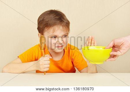 Little boy refuses to eat a cereal