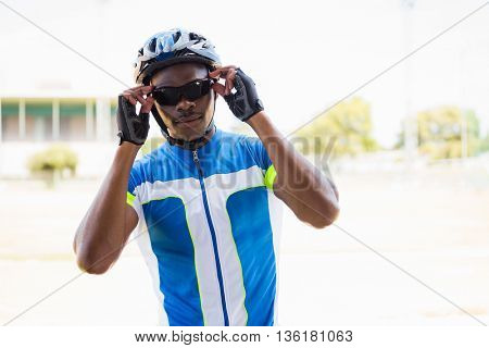 Athlete wearing cycling goggles in stadium