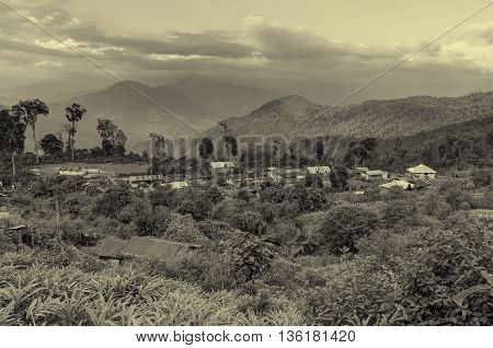 Beautiful view of Silerygaon Village with Kanchenjunga mountain range at the background morning light at Sikkim India. Tinted stock image.