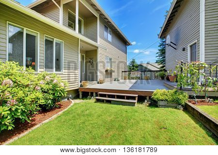 Wooden Walkout Deck With Hoop, Bench And Pots.