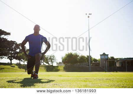 Athlete warming up in a stadium on a sunny day