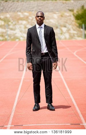 Confidence businessman standing on a racing track