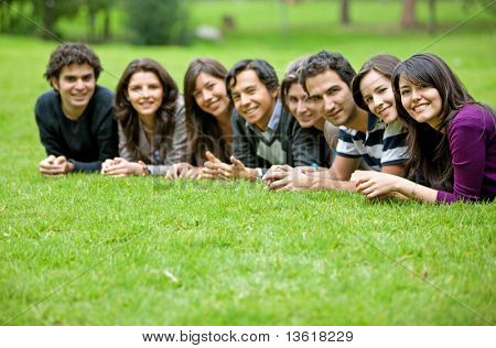 group of people outdoors smiling and looking happy
