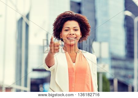 business, gesture, hiring and people concept - young smiling african american businesswoman pointing finger on you in city