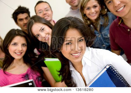 friends or university students smiling in a classroom