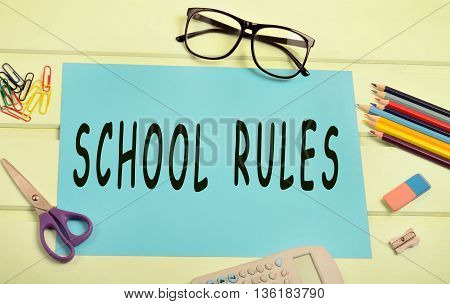 The words School rules on blue paper