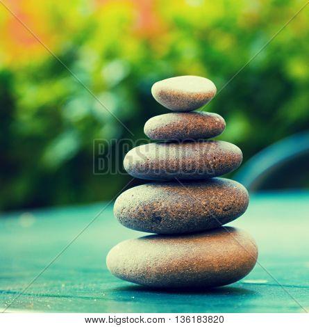 Pyramid of pebbles. Toned photo