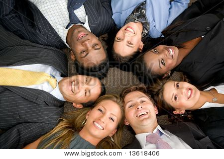 business people teamwork in an office with heads together