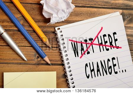 The words Wait here Change on notebook