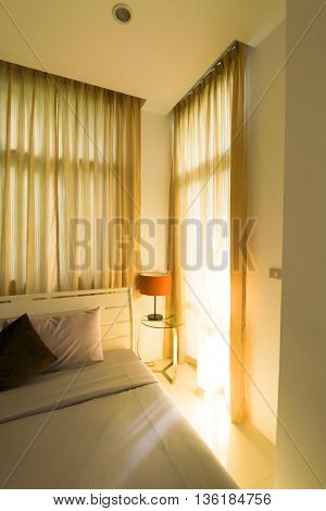 window curtain and sunlight splashed into the bedroom.