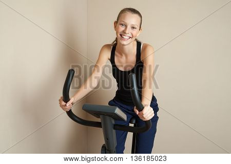 portrait of smiling girl riding cycle at home in morning