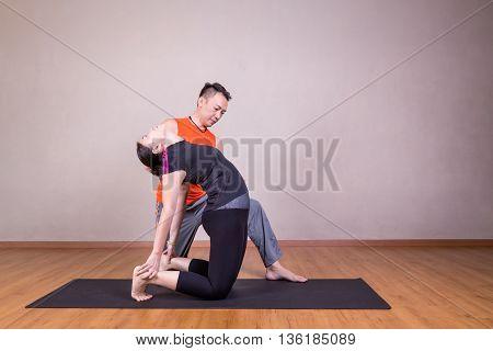Yoga Instructor Guiding Student Perform Camel Pose Or Utrasana