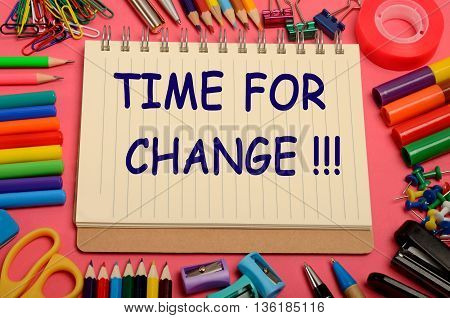 The words Time for change on notebook