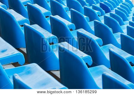 Background of empty blue seats in a stadium, back view