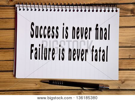 Text Success is never final Failure is never fatal on notebook