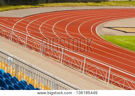 Running track for the sport background. Turning on track of stadium