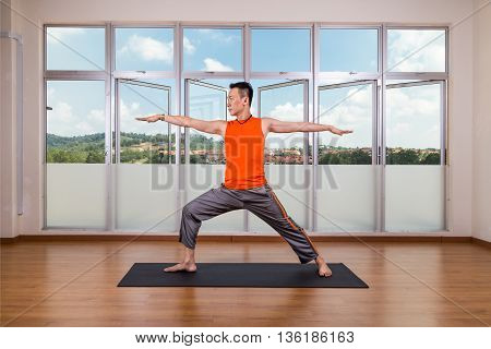 Yoga Practitioner Performing Warrior 2 Or Virabhadrasana 2 Pose