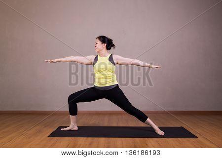 Female Performing The Warrior 2 Or Virabhadrasana 2 Yoga Pose