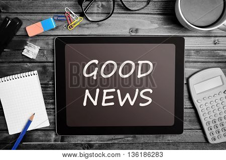 The words Good News on tablet pc
