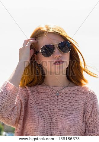 Red-haired Girl Is In Sunglasses