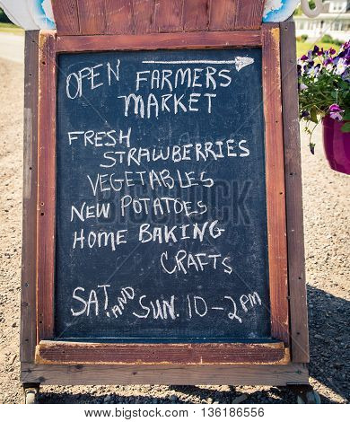 A chalkboard with farmers market on it in nova Scotia