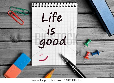 The words Life is good on notebook