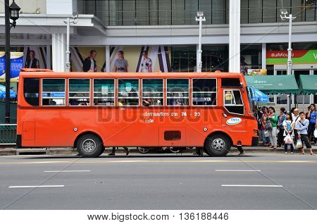Unidentified Passengers Waits For Public Bus In Bangkok
