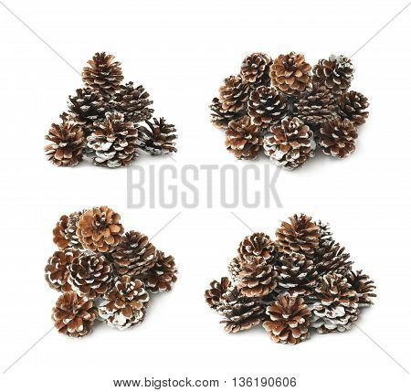 Pile of decorational pine cones covered with artificial snow, composition isolated over the white background, set of four different foreshortenings