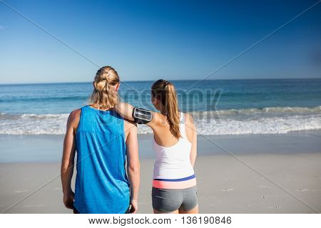 Friends looking at the sea on a sunny day