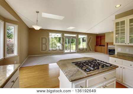 Empty House Interior With Open Floor Plan. Living Room With View Of The Kitchen Area.