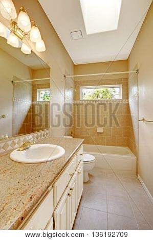 Light Bathroom Interior With Wooden Cabinets And Tile Floor.