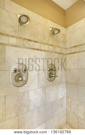 Modern Shower With Beige Tiles And Two Heads.