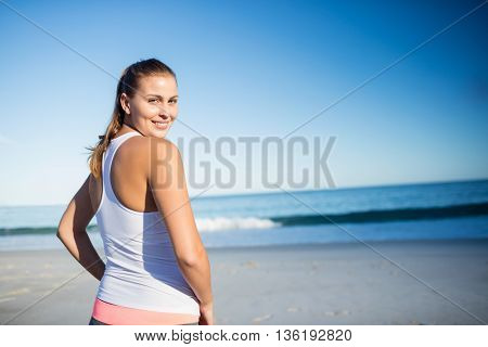 Woman standing at the beach on a sunny day