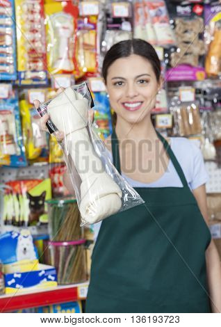 Confident Saleswoman Showing Dog Chew Bone