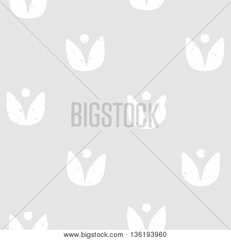 Block print seamless pattern with floral motif. White flowers on light grey background