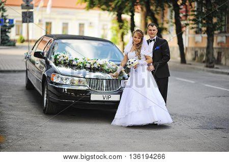 Wedding Couple Stay Near Black Luxury Limousine