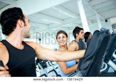 group of people doing cardio at a gym