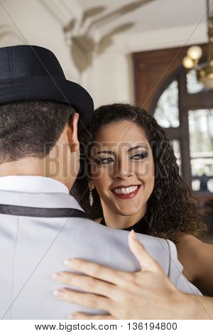 Female Dancer Looking Away While Performing Tango With Man