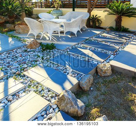 Decorated stone garden furniture table and chairs in resort hotel