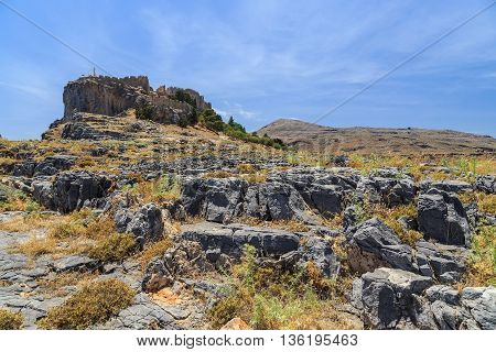 view of the Acropolis of Lindos from rocks below. Rhodes Greece