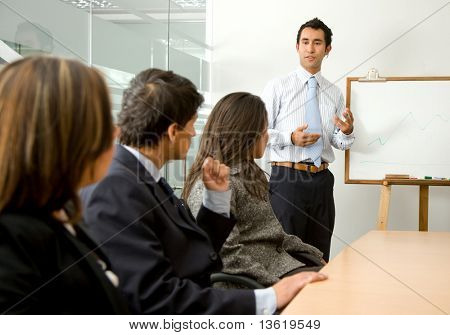 business man doing a presentation in an office