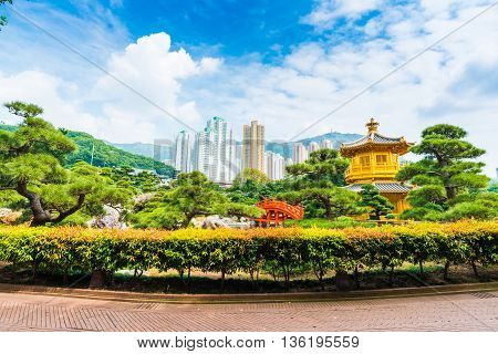 The Golden Pavilion of Absolute Perfection inside Nan Lian Garden with green tree background. Hongkong