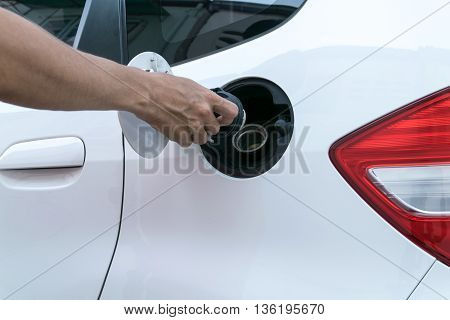 Hand opening the oil filler cap,  pump, diesel