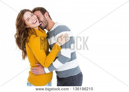 Happy young couple cuddling each other on white background