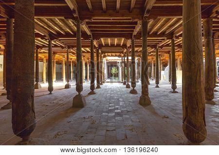 KHIVA, UZBEKISTAN - MAY 23, 2016: Wooden beams and columns of the Juma Mosque, in Khiva, Uzbekistan.