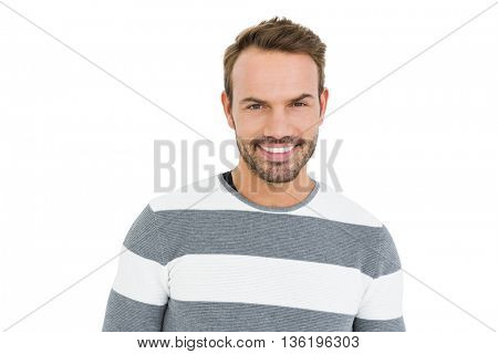 Portrait of happy young man in winter wear on white background